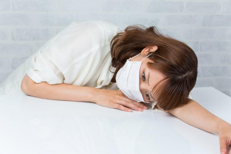 マスク / 体調不良の女性